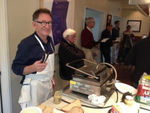 Chef Mark Peel serves up some of his famous grilled cheese sandwiches for the volunteers.