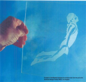 Example of sandblasted swimmer, part of the Shared Skies artwork for the new YMCA.